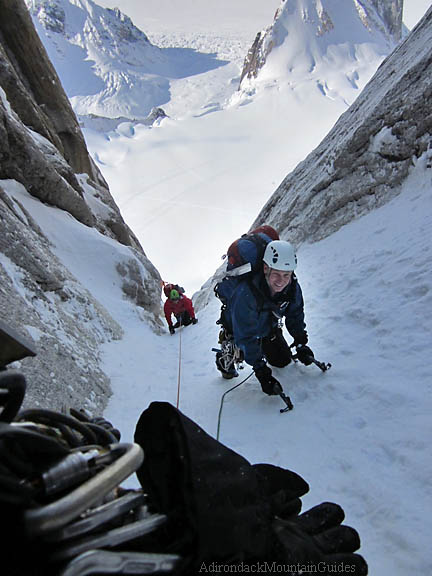 Jay Abbey and Erik Weihenmayer heading up Ham & Eggs Couloir on the Moose's Tooth in Alaska. Photo by Ian Osteyee.