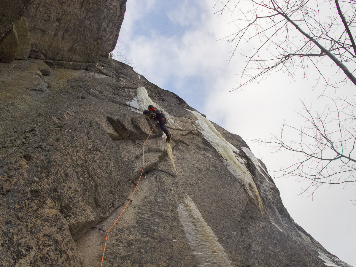 Ray Rice moving above his gear and into the ice on the first ascent. Photo Peter Doucette