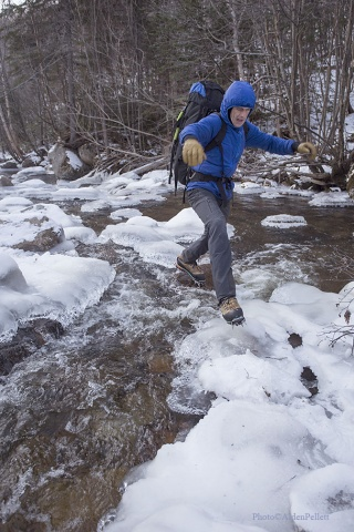 Ryan Stefiuk steps lightly on the brook crossing to reach Mont Gros Bras (Big Arm) in Quebec.