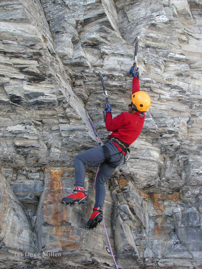 Kim Csizmazia navigating the varied and loose shale of Pont Rouge during the mixed climbing competition. Note the leashes on the tool