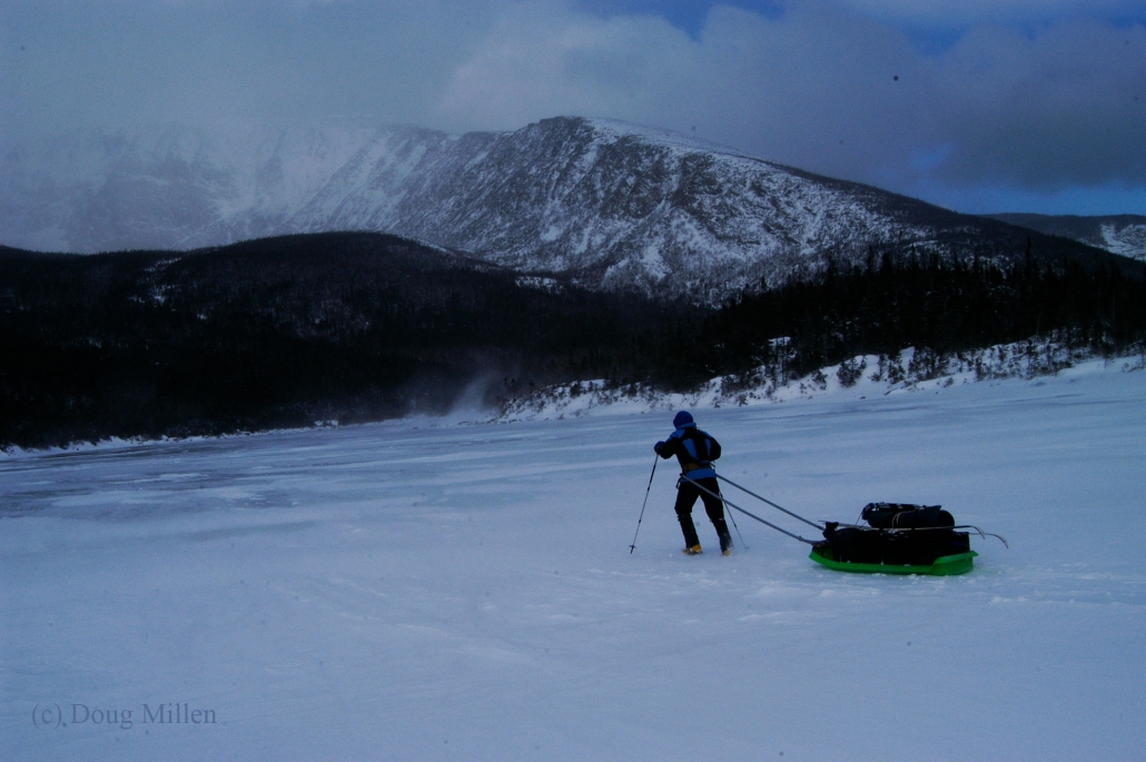 Pam Banks battling a little wind crossing the South Basin Pond on her way to the Chimney Pond cabins - Photo: Doug Millen